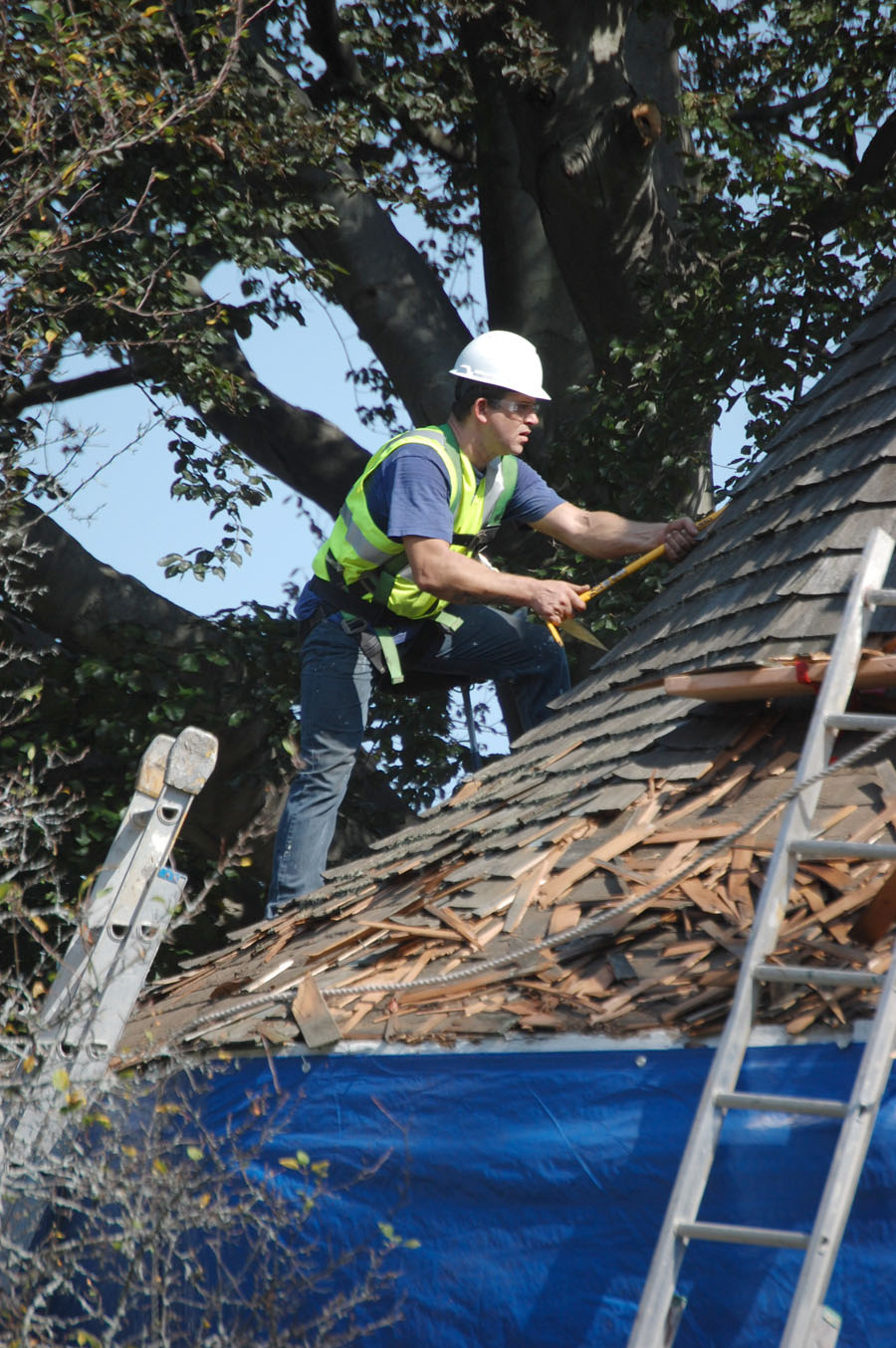 Growing pile of debris from old shingles