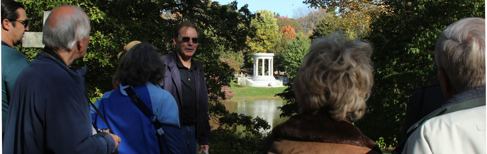 A scenic view of Mary Baker Eddy's grave and monument at Mount Auburn Cemetery