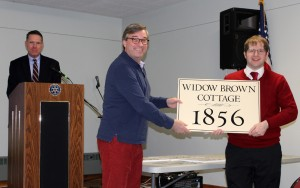 Ian Watson accepts the Historic House Plaque for the Widow Brown's Cottage on Clark Street