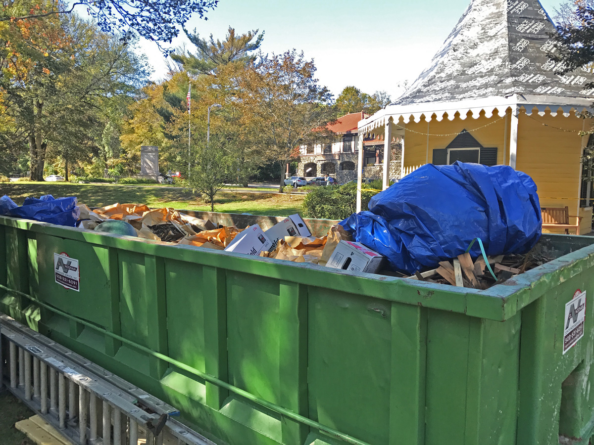 Old shingles and debris ready for trash disposal