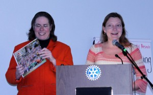 Ellen Schreiber(left) and Diane Miller, co-chairs of the Friends of Joey's Park, present a scrapbook for the Claflin Room's collection