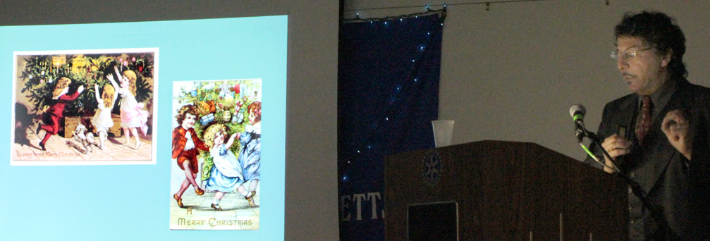 On Wednesday evening, December 18th, Kenneth Turino from Historic New England presented a well-illustrated lecture about the evolution of the celebration of Christmas in New England from 1620 to the present day. The slide in this photograph shows early Christmas cards from the 19th century.